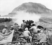 37mm_Gun_fires_against_cave_positions_at_Iwo_Jima