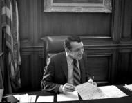 Harvey_Milk_in_1978_at_Mayor_Moscones_Desk-e1385584145564