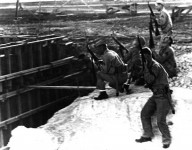 Marines_with_rifles_at_MCAS_Ewa_during_Japanese_attack_1941