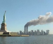 National_Park_Service_9-11_Statue_of_Liberty_and_WTC_fire1