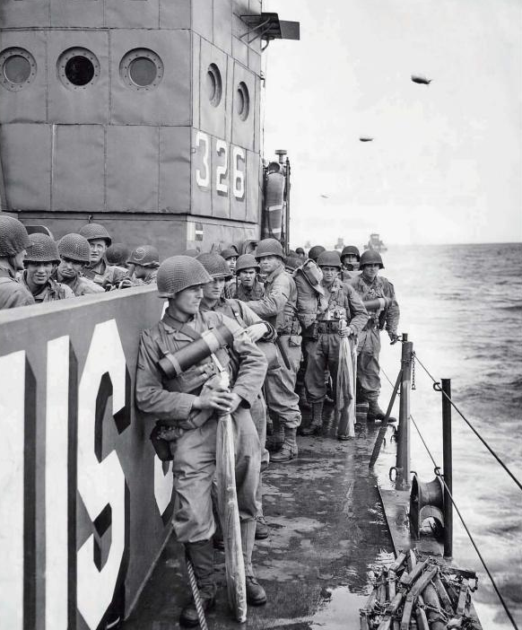 Group of U.S. soldiers from the 359th Infantry Regiment, 90th Infantry Division bound for Utah Beach on LCI(L)-326 on D-Day afternoon. Source: U.S. National Archives, # 26-G-2402.