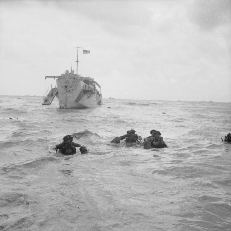 Troops wading ashore. (June 6, 1944). Source: Imperial War Museums, B 5092.