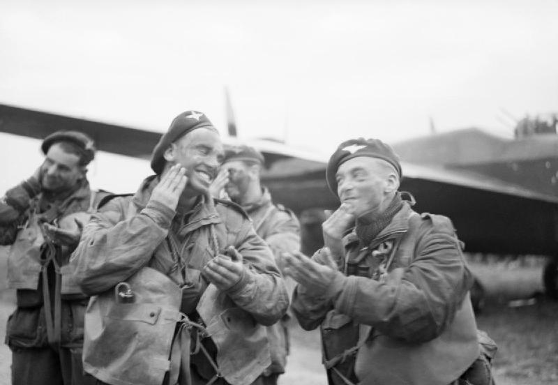 Paratroops of 6th Airborne Division blackening their faces in front of an Albemarle aircraft at RAF Harwell. (June 5, 1944). Source:  Imperial War Museums, # H 39066.