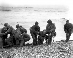 American landing party helping out on Omaha Beach, France. (June 6, 1944). Source: Center of Military History.