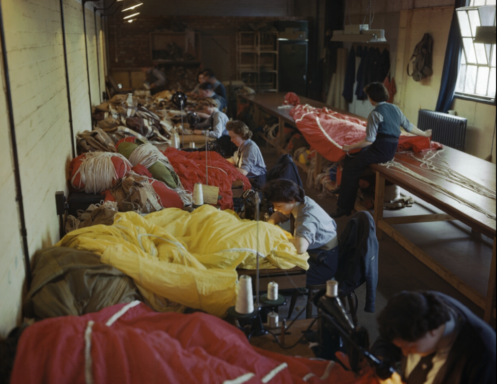 Members of the Womens Auxiliary Air Force (WAAF) repair and pack parachutes for use by airborne troops during the Normandy invasion. (May 31, 1944). Source: Imperial War Museums,  TR 1783.