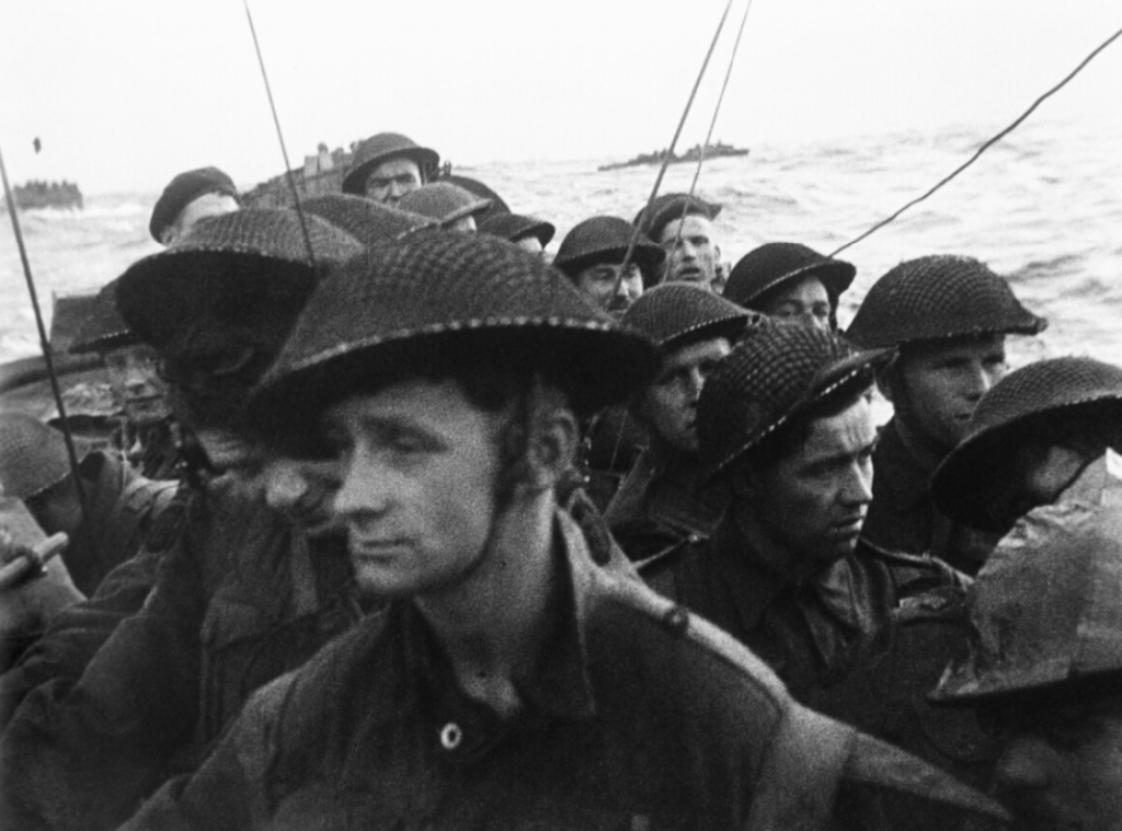 Film still showing commandos of No. 4 Commando, 1st Special Service Brigade, aboard a LCI(S) landing craft on their approach to Queen Red beach, Sword area. (June 6, 1944). Source: Imperial War Museums, # BU 1181.