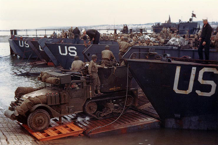 U.S. Army half-track antiaircraft machine gun vehicle backed into the well deck of a U.S. Navy LCT in prep for the Normandy invasion. (Late May or early June, 1944). Source: U.S. National Archives, # USA C-751.