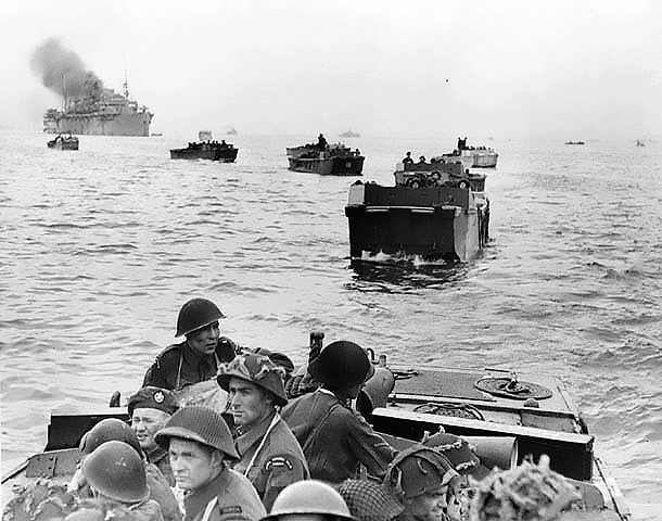 Troops of the Canadian Royal Winnipeg Rifles regiment approaching Juno Beach, Normandy, France aboard LCA landing craft. (June 6, 1944). Source: National Archives of Canada, # PA-132651.