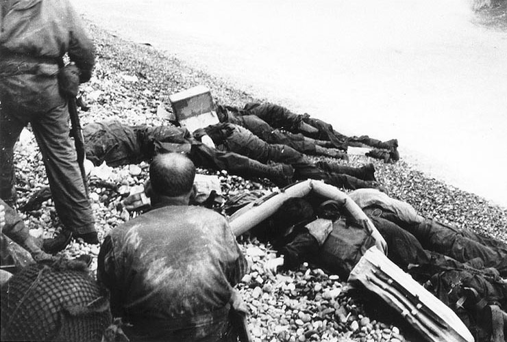 Dead American soldiers of 3rd Battalion, 16th Infantry Regiment, 1st Infantry Division on Omaha Beach in Normandy. (June 6, 1944). Source: U.S. National Archives, # SC 189924.