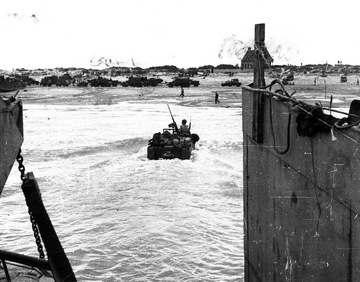 U.S. Army weapons carrier moved through the surf toward Utah Beach, Normandy, after being launched from its landing craft. (June 6, 1944). Source: U.S. National Archives, # SC 190438.