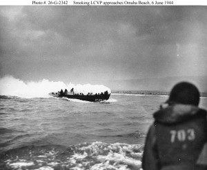 Smoking LCVP approaches Omaha Beach. (June 6, 1944). Source: U.S. National Archives, # 26-G-2342.