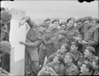 Men of 22nd Independent Parachute Company, 6th Airborne Division being briefed for the invasion. (June 4-5, 1944). Source: Imperial War Museums, # H 39089.