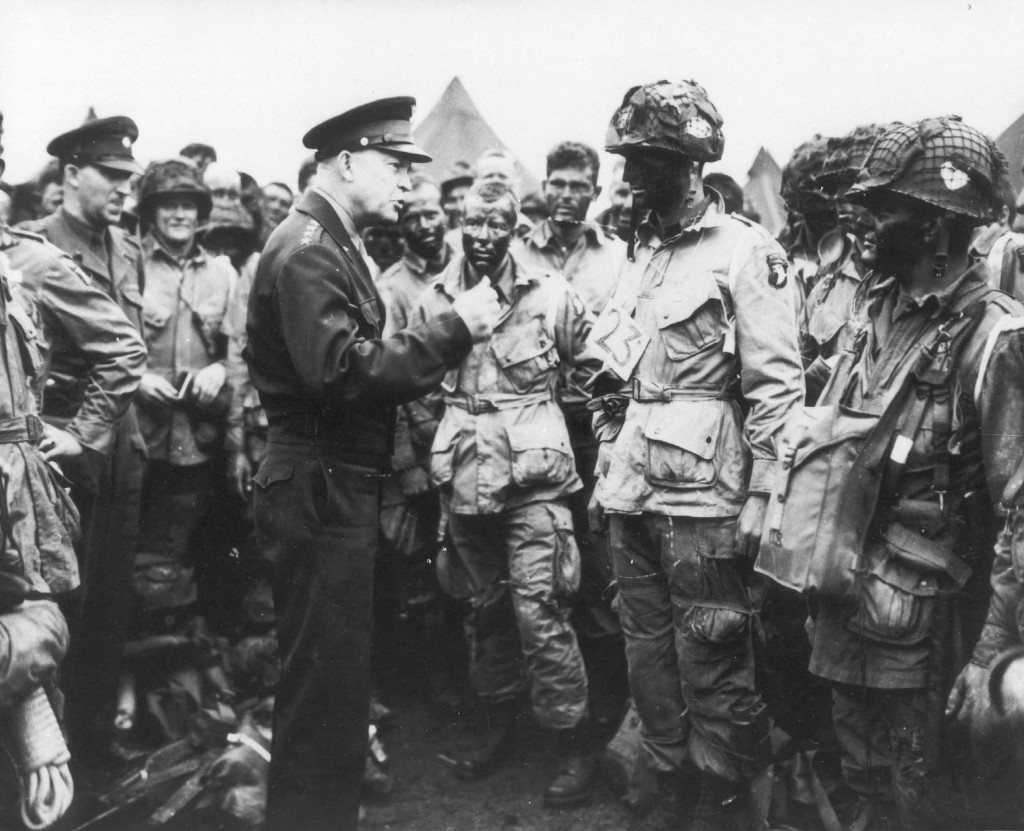 """General Dwight D. Eisenhower gives the order of the day: """"Full victory-nothing else"""" to paratroopers in England. (June 5, 1944). Source: U.S. National Archives, # 111-SC-194399"""