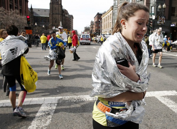Runner crying after the Boston Marathon bombing (2013). Source: Winslow Townson.