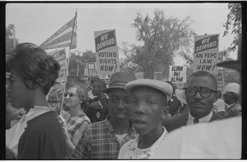 Demonstrators holding signs during the March on Washington. Photographed by Marion S. Trikosko. (Aug. 28, 1963). Source: Library of Congress #LC-DIG-ds-04668.