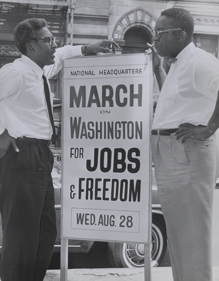 Bayard Rustin & Cleveland Robinson in front of 170 W 130 St., March on Washington. (Aug. 7, 1963). Source: World Telegram, Sun Newspaper, Library of Congress #LC-DIG-ppmsca-35538.
