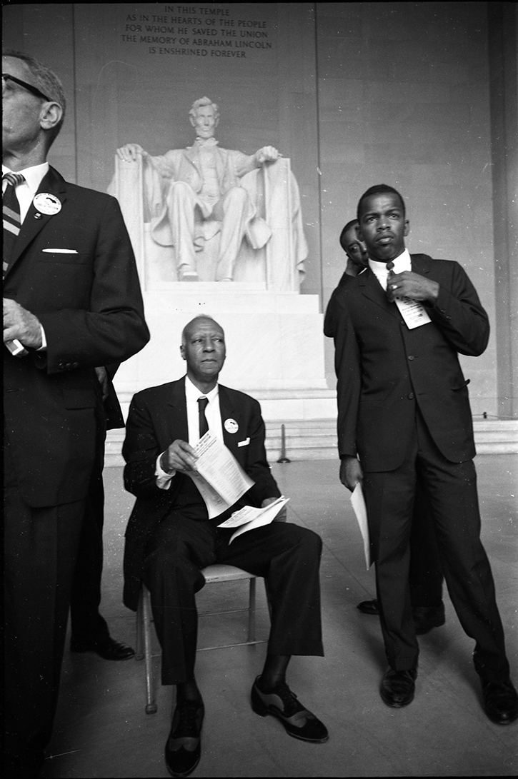 A. Philip Randolph, seated, and John Lewis, standing in front of Lincoln Memorial during the March. (Aug. 28, 1963). Source: LOOK Magazine Photograph Collection, Library of Congress #042.00.00. © Stanley Tretick.