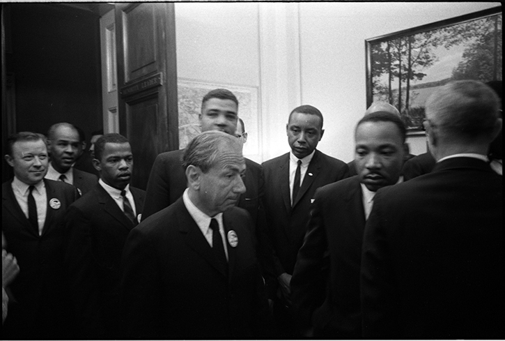 Organizers of the March on Washington, from left: Walter P. Reuther, Roy Wilkins, John Lewis, Rabbi Joachim Prinz, Whitney Young, Floyd McKissick, & Martin Luther King, Jr., enter congressional chambers to officially present demands. (Aug. 28, 1963). Source: LOOK Magazine Photograph Collection, Library of Congress #044.00.00. © Stanley Tretick.