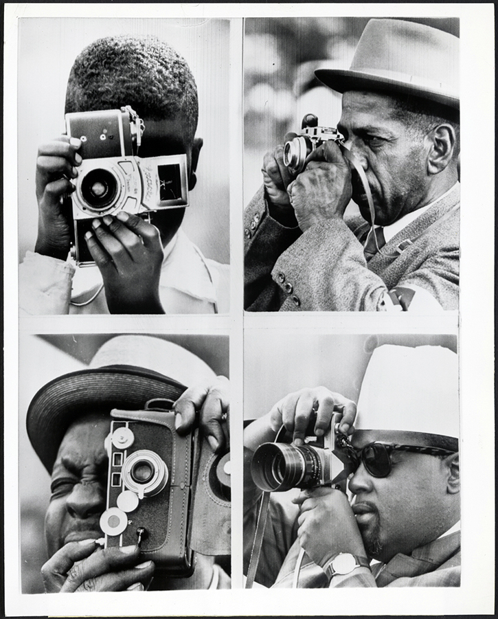 """Like Everyday Tourists."" 4 men wield cameras during the March. (Aug. 28, 1963). Source: United Press International, New York World-Telegram & the Sun Newspaper Photograph Collection, Library of Congress #041.00.00."