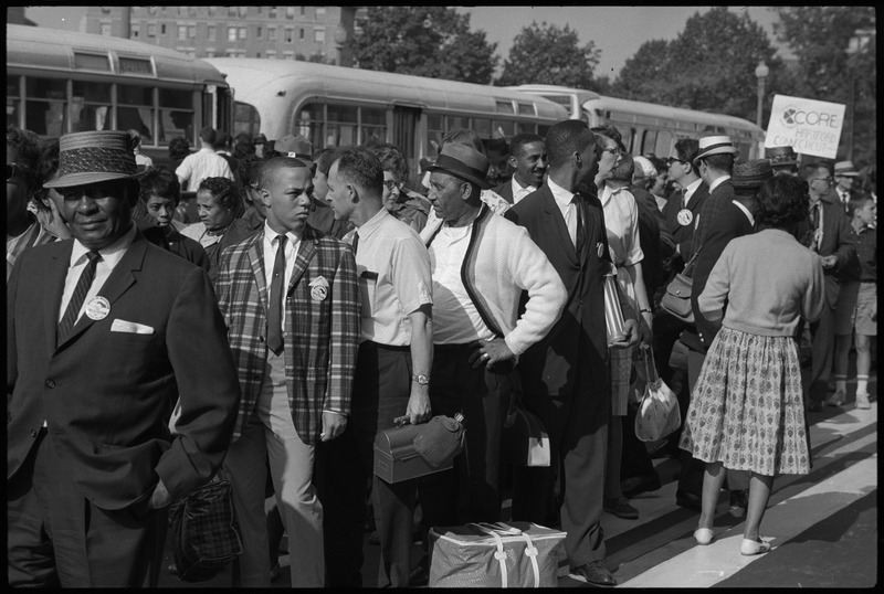 """Marchers arriving by bus, with """"CORE Downtown"""" sign. (Aug. 28, 1963). Photographed by Marion S. Trikosko. Source: Library of Congress #LC-DIG-ppmsca-37224."""