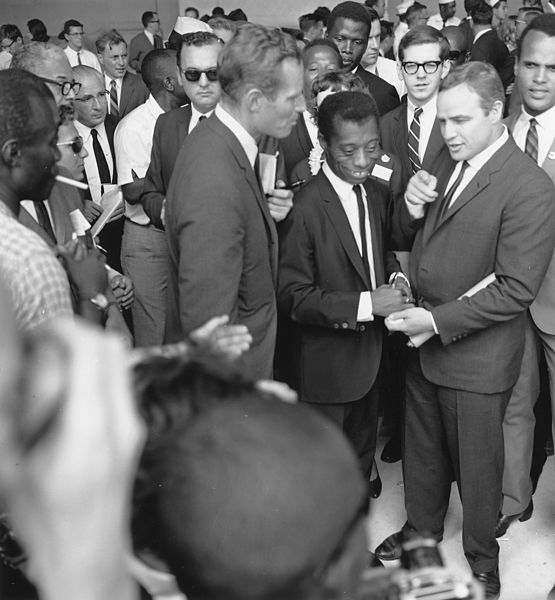 Author James Baldwin with actors Marlon Brando and Charlton Heston at the March.  (Aug. 28, 1963). Source: U.S. National Archives #542051.