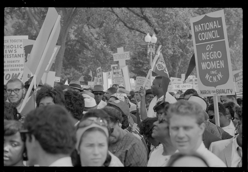 """Marchers with """"National Council of Negro Women"""" sign at the March. Photographed by Marion S. Trikosko. (Aug. 28, 1963). Source: Library of Congress #LC-DIG-ppmsca-37231."""