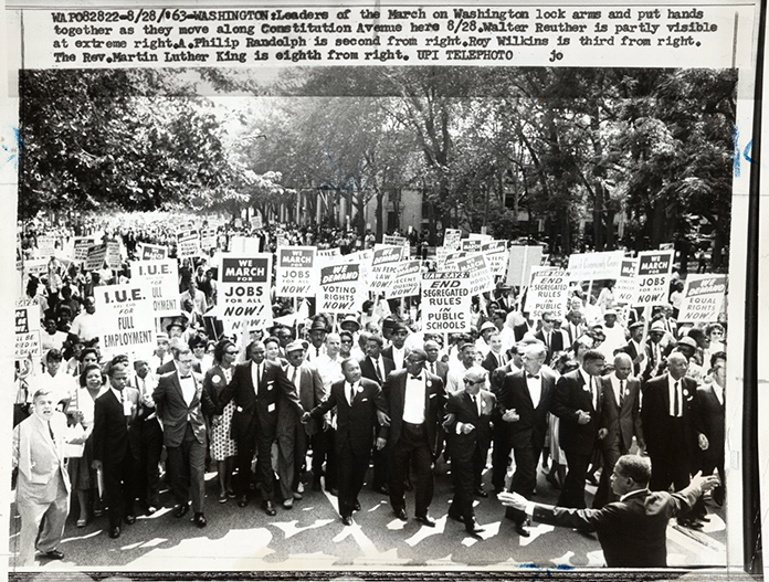Leaders of the March on Washington lock arms...Walter Reuther is partly visible at right. A. Philip Randolph is second from right. Roy Wilkins is third from right. Rev. Martin Luther King is eighth from right. Source: United Press International, Library of Congress #040.00.00.