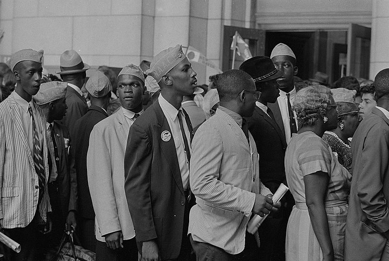 Young men in NAACP caps in front of Union Station, during the March. Photographed by Marion S. Trikosko. (Aug. 28, 1963). Source: Library of Congress #LC-DIG-ppmsca-37243.
