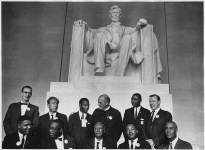 Leaders of the march posing in front of the statue of Abraham Lincoln, Lincoln Memorial.  (Aug. 28, 1963). Source: U.S. National Archives #542063.