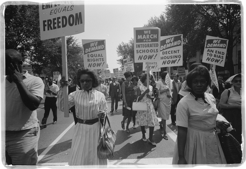 Women carrying signs for equal rights, integrated schools, decent housing, & an end to bias. Photographed by Warren K. Leffler. (Aug. 28, 1963). Source: Library of Congress #LC-DIG-ppmsca-03128.